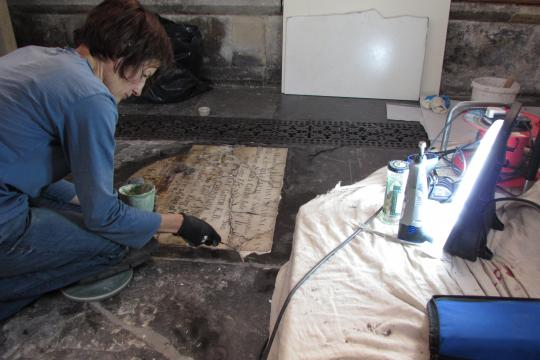 A woman carrying out reparis on the Abbey floor