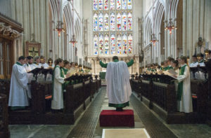 Bath Abbey choirs of Girls and Lay-clerks singing at a service