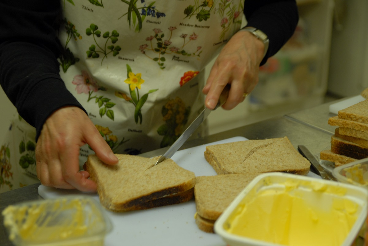Volunteer making sandwiches