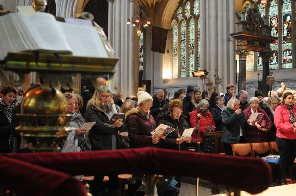 People singing at one of our festive carols services