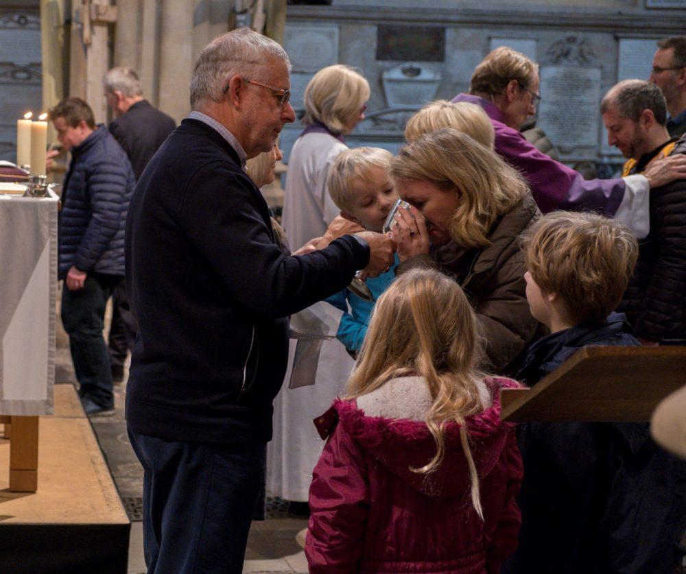 Family taking Communion at Parish Communion service