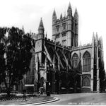 An old, black and white photo of the outside of Bath Abbey