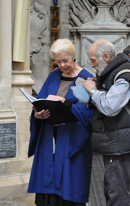 Steward talking to visitor in Bath Abbey