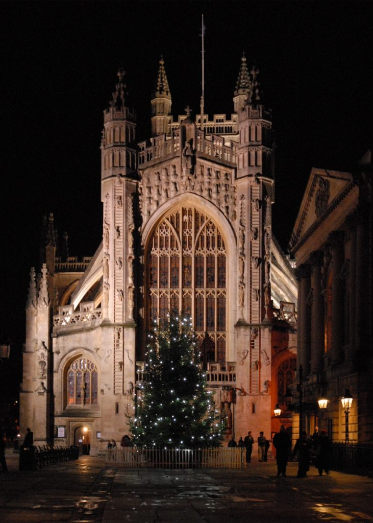 Front of the Abbey at night with Christmas tree in front