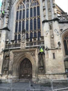 Abseiling stonemasons from Sally Strachey History Conservation (SSHC) check Bath Abbey's West front