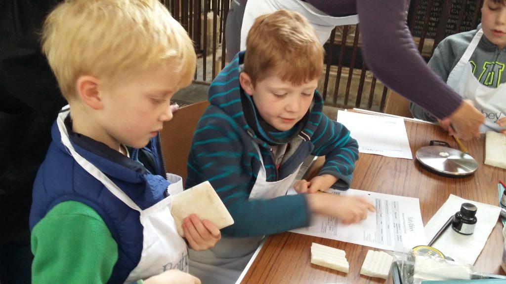 Boys enjoying activity at Science Busking Day