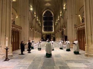 Bath Abbey Choir of Lay Clerks singing in Bath Abbey while socially distanced