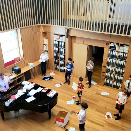 e of the Bath Abbey Boys Choir and Huw Williams, Director of Music, during practice session in Song School