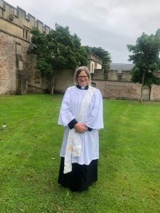 Cath Candish in clergy robes pictured after her ordination service at Wells Cathedral