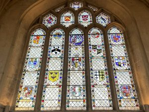 Stained glass window in Bath Abbey depicting family crests