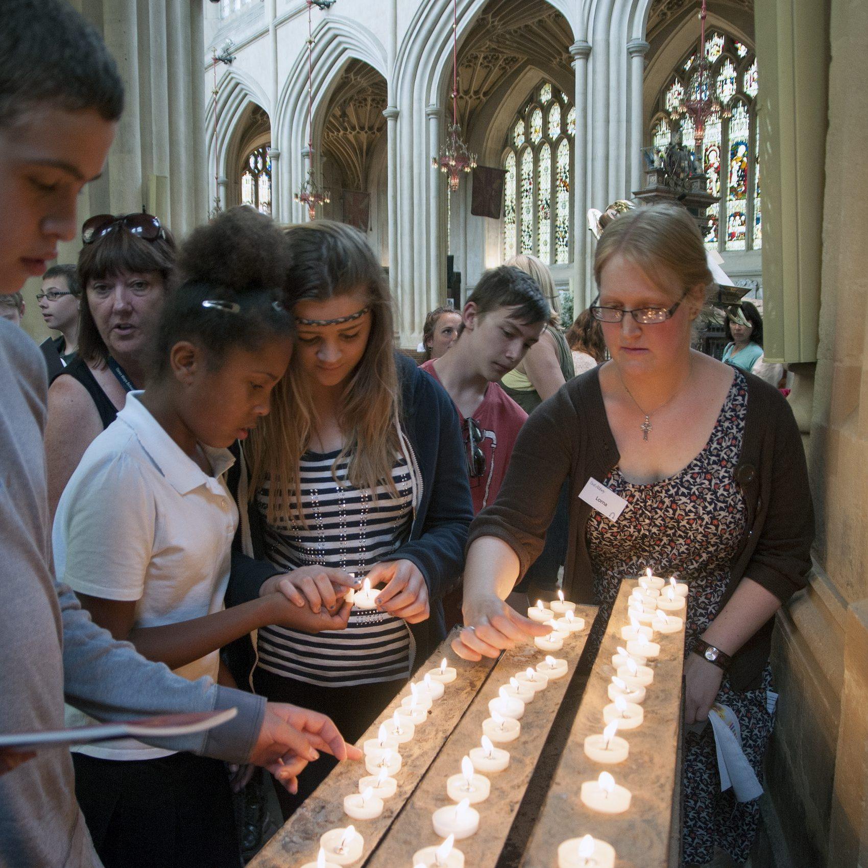 Children from Three Ways school lighting candles
